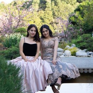 Selling the black and blush pink gown (left)